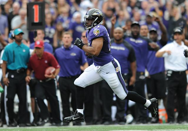 Baltimore Ravens inside linebacker Daryl Smith runs an interception back for a touchdown in the first half of an NFL football game against the Houston Texans, Sunday, Sept. 22, 2013, in Baltimore. (AP Photo/Gail Burton)