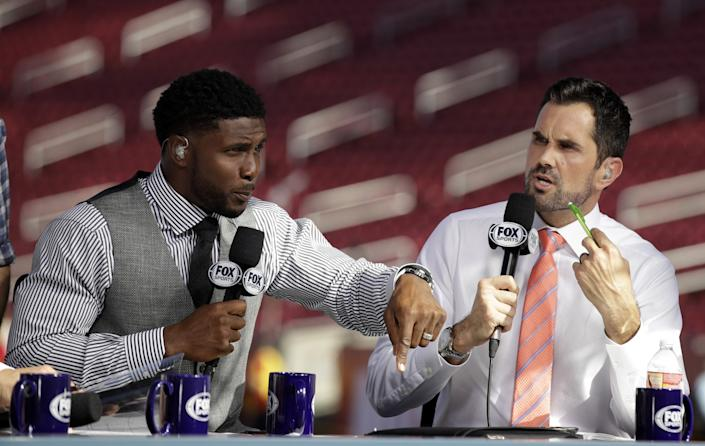Former USC players Reggie Bush, left, and Matt Leinart rehearse for a Fox Sports pregame show.