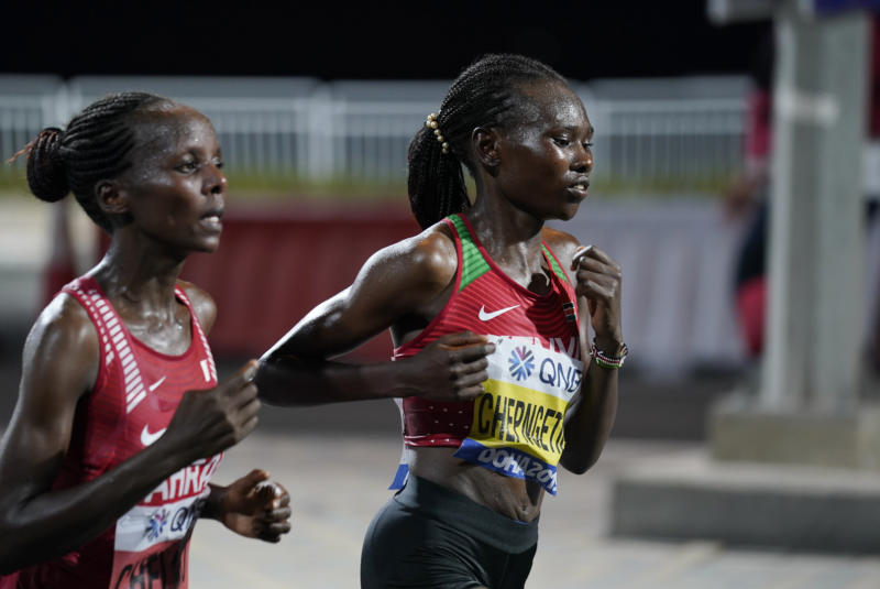 Ruth Chepngetich, of Kenya, right, leads Rose Chelimo, of Bahrain, during the women's marathon at the World Athletics Championships in Doha, Qatar, Saturday, Sept. 28, 2019. Chepngetich won the marathon. (AP Photo/Nick Didlick, Pool)