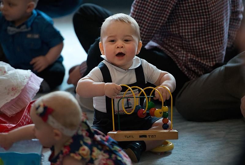 WELLINGTON, NZ - APRIL 09: Prince George of Cambridge plays during a Plunket nurse and parents group visit at Government House on April 9, 2014 in Wellington, New Zealand. Plunket is a national not-for-profit organization that provides care for children and families in New Zealand. The Duke and Duchess of Cambridge are on a three-week tour of Australia and New Zealand, the first official trip overseas with their son, Prince George of Cambridge. (Photo by Marty Melville-Pool/Getty Images)