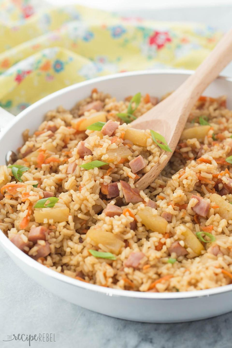 """<p>This Hawaiian inspired rice isn't just quick and simple, it's healthy too! Savoury cubes of ham and sweet chunks of pineapple adds a punch of flavour, and since this dish comes together without frying, it's a healthy choice too. <i>[Image : The Recipe Rebel]</i></p><p>Get the recipe from: <b><a href=""""http://www.thereciperebel.com/20-minute-ham-and-pineapple-rice/"""" rel=""""nofollow noopener"""" target=""""_blank"""" data-ylk=""""slk:The Recipe Rebel"""" class=""""link rapid-noclick-resp"""">The Recipe Rebel</a></b></p>"""