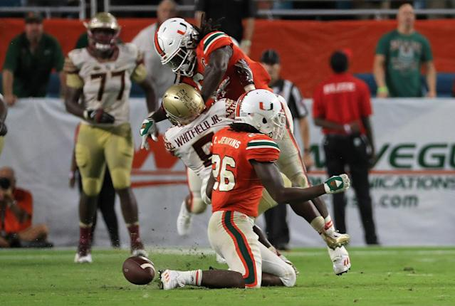 "MIAMI GARDENS, FL – OCTOBER 08: Jamal Carter Sr. #6 of the Miami Hurricanes hits Kermit Whitfield #8 of the <a class=""link rapid-noclick-resp"" href=""/ncaab/teams/fan/"" data-ylk=""slk:Florida State Seminoles"">Florida State Seminoles</a> for a personal foul during a game at Hard Rock Stadium on October 8, 2016 in Miami Gardens, Florida. (Photo by Mike Ehrmann/Getty Images)"