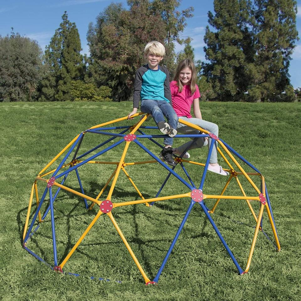 """<p>Upgrade their backyard with this cool <a href=""""https://www.popsugar.com/buy/Easy-Outdoor-Space-Dome-Climber-568696?p_name=Easy%20Outdoor%20Space%20Dome%20Climber&retailer=amazon.com&pid=568696&price=270&evar1=moms%3Aus&evar9=25997679&evar98=https%3A%2F%2Fwww.popsugar.com%2Fphoto-gallery%2F25997679%2Fimage%2F45499365%2FEasy-Outdoor-Space-Dome-Climber&list1=holiday%2Cgift%20guide%2Ckid%20shopping%2Choliday%20living%2Choliday%20for%20kids&prop13=api&pdata=1"""" class=""""link rapid-noclick-resp"""" rel=""""nofollow noopener"""" target=""""_blank"""" data-ylk=""""slk:Easy Outdoor Space Dome Climber"""">Easy Outdoor Space Dome Climber</a> ($270).</p>"""