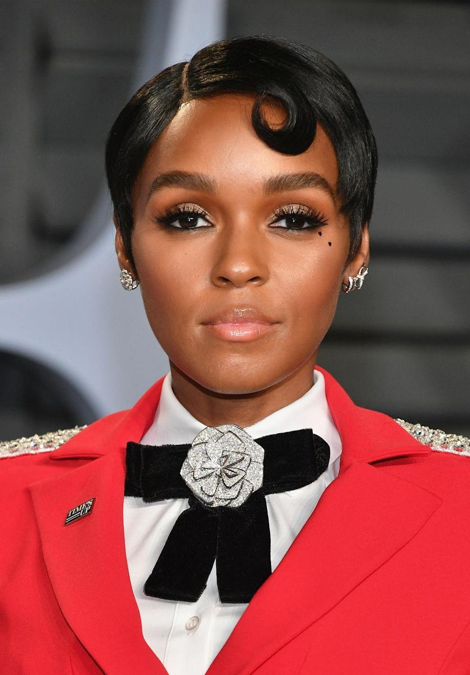 <p>With short hair, it's all about the details. See: this sleek side part and vintage-inspired spit-curl on Janelle Monae.</p>