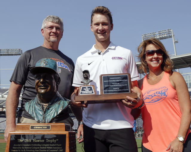 "Brady Singer's parents have already watched him post an incredible career at Florida. Next up: his <a class=""link rapid-noclick-resp"" href=""/mlb/teams/kan"" data-ylk=""slk:Royals"">Royals</a> career. (AP Photo)"