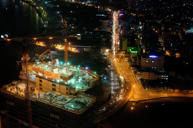 HO CHI MINH CITY, VIETNAM - FEBRUARY 21: Construction of a new hotel is seen from above at the Saigon skydeck February 21, 2011 in Ho Chi Minh City, Vietnam. The 68 floor Bitexco skyscraper is the tallest building in Vietnam, it opened in October 2010. Over the past year many luxury brands have surfaced in new shopping centers as wealthy Vietnamese spend their money for high priced cars and expensive items.Vietnam has experienced rapid growth since it made a shift to a socialist- oriented market economy, slowly integrating into the world's economy. In 2010 the GDP reached $104.6 billion. According to a forecast by the Pricewaterhouse Coopers in 2008, Vietnam may be the fastest growing of emerging economies by 2025, with a potential growth rate of almost 10% per year. (Photo by Paula Bronstein /Getty Images)