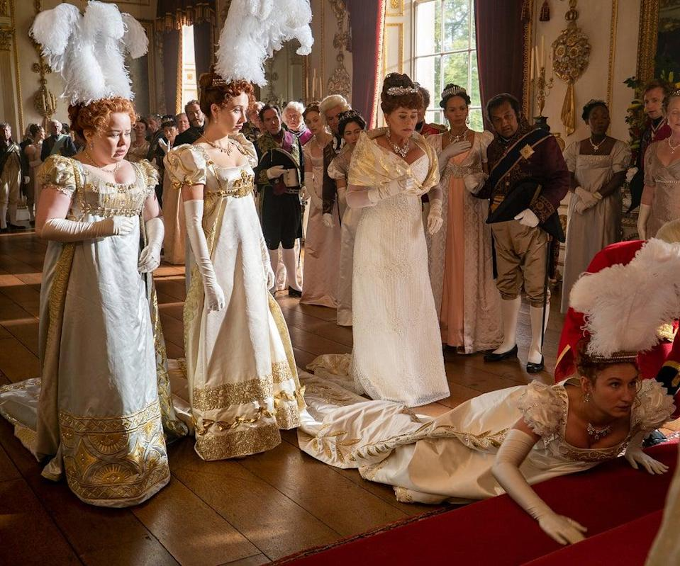 BRIDGERTON (L to R) NICOLA COUGHLAN as PENELOPE FEATHERINGTON, HARRIET CAINS as PHILLIPA FEATHERINGTON, BESSIE CARTER as PRUDENCE FEATHERINGTON and POLLY WALKER as PORTIA FEATHERINGTON in episode 101 of BRIDGERTON Cr. LIAM DANIEL/NETFLIX © 2020