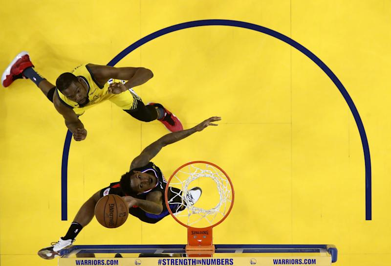 OAKLAND, CALIFORNIA - APRIL 15: Lou Williams #23 of the LA Clippers goes up for a shot on Kevin Durant #35 of the Golden State Warriors during Game Two of the first round of the 2019 NBA Western Conference Playoffs at ORACLE Arena on April 15, 2019 in Oakland, California. NOTE TO USER: User expressly acknowledges and agrees that, by downloading and or using this photograph, User is consenting to the terms and conditions of the Getty Images License Agreement. (Photo by Ezra Shaw/Getty Images)