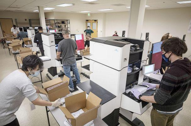 PHOTO: Workers wearing protective masks and gloves sort ballots at the Contra Costa County Clerk Office in Martinez, Calif., Oct. 27, 2020. (Bloomberg via Getty Images)