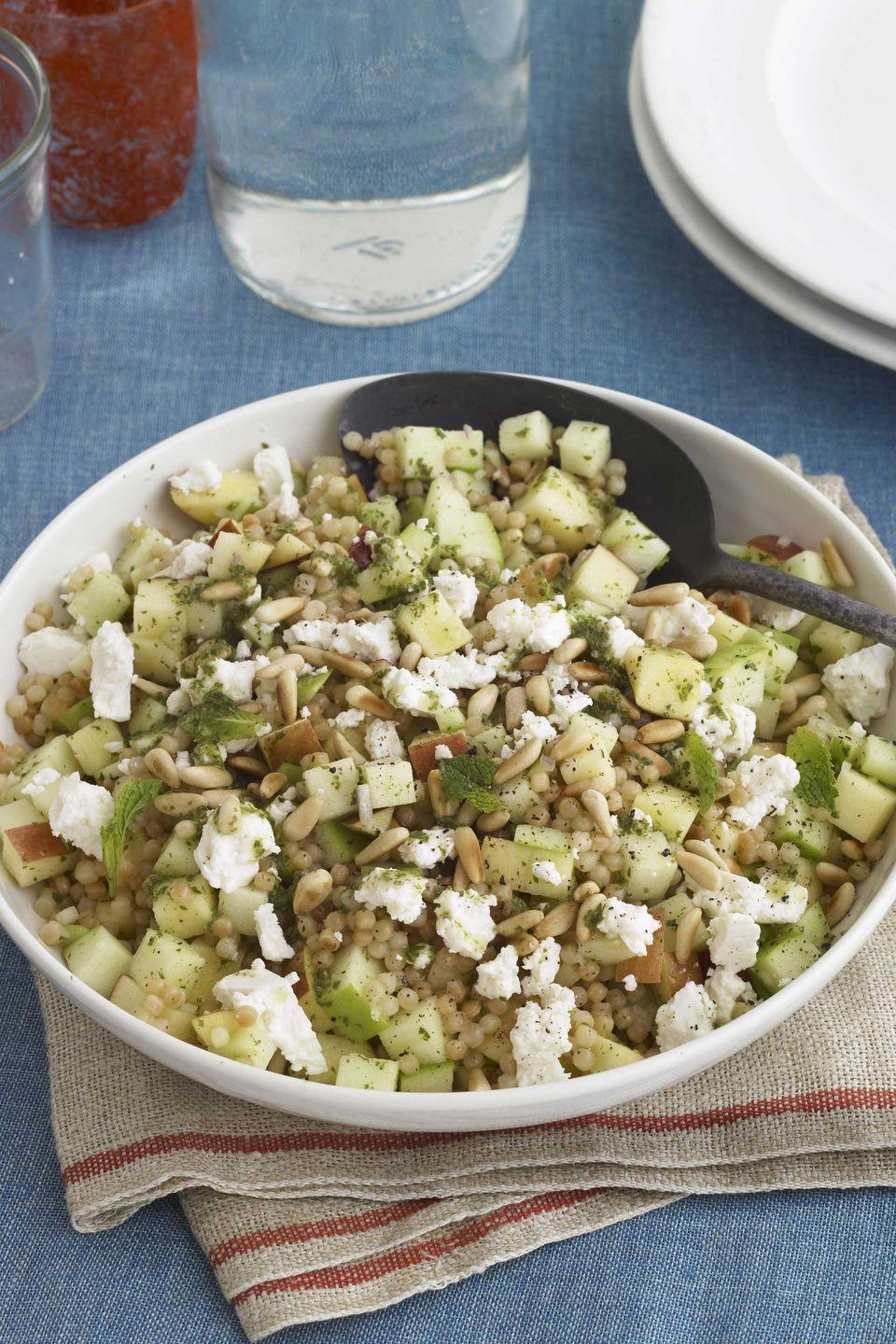 "<p>A minty lemon dressing brightens an Israeli couscous salad made with crumbled feta, toasted pine nuts, and crunchy Galas and Calville Blanc d'Hiver apples.</p><p><strong><a href=""https://www.countryliving.com/food-drinks/recipes/a3443/israeli-couscous-apple-salad-recipe-clv0910/"" rel=""nofollow noopener"" target=""_blank"" data-ylk=""slk:Get the recipe"" class=""link rapid-noclick-resp"">Get the recipe</a>.</strong></p>"