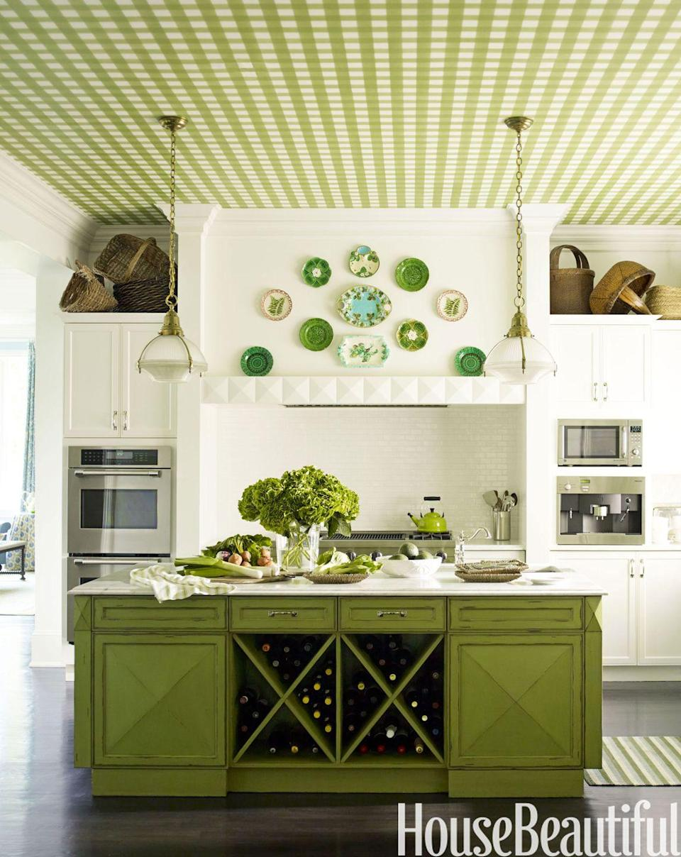 "<p>A <span class=""redactor-unlink"">green gingham ceiling and pea-green cabinets by designer Gideon Mendelso</span> give an otherwise classic kitchen some cool points. </p>"