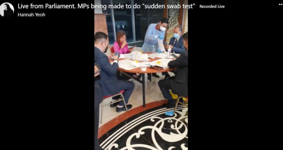 A screengrab of Segambut MP Hannah Yeoh's 'live' Facebook video broadcast shows several lawmakers taking the Covid-19 swab test at Parliament lobby, July 29, 2021. — Screengrab from Facebook/Hannah Yeoh