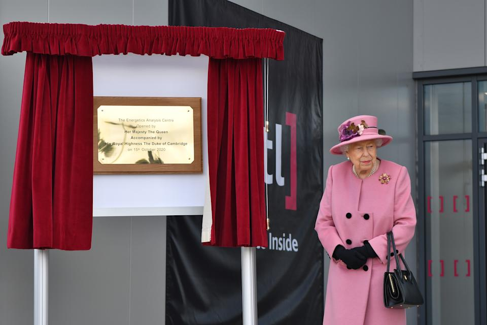 SALISBURY, ENGLAND - OCTOBER 15: Britain's Queen Elizabeth II (R) is seen after she unveiled a plaque to officially open the new Energetics Analysis Centre at the Defence Science and Technology Laboratory (Dstl) at Porton Down science park on October 15, 2020 near Salisbury, England. The Queen and the Duke of Cambridge visited the Defence Science and Technology Laboratory (Dstl) where they were to view displays of weaponry and tactics used in counter intelligence, a demonstration of a Forensic Explosives Investigation and meet staff who were involved in the Salisbury Novichok incident. Her Majesty and His Royal Highness also formally opened the new Energetics Analysis Centre. (Photo by Ben Stansall - WPA Pool/Getty Images)