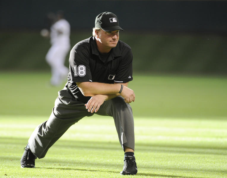 FILE - In this May 27, 2011 file photo, Major League Baseball umpire Brian Runge stretches before a baseball game between the Houston Astros and the Arizona Diamondbacks in Houston. Two people familiar with the situation tell The Associated Press that a Major League Baseball umpire was recently dismissed for what was believed to be the first known drug ouster among umps. The two people tell the AP that Runge failed at least one drug test, then reached an agreement so he could remain on the umpire roster. When he failed to comply with those terms, he was released. The people spoke on condition of anonymity because MLB didn't publicly say why Runge was gone.(AP Photo/Pat Sullivan, File)