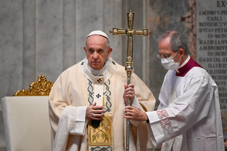 Pope Francis (L), assisted by Master of Pontifical Liturgical Ceremonies, Italian priest Guido Marini, celebrates a Holy Mass as part of World Youth Day on November 22, 2020 at St. Peter's Basilica in The Vatican. (Photo by Vincenzo PINTO / POOL / AFP) (Photo by VINCENZO PINTO/POOL/AFP via Getty Images) (Photo: VINCENZO PINTO via Getty Images)