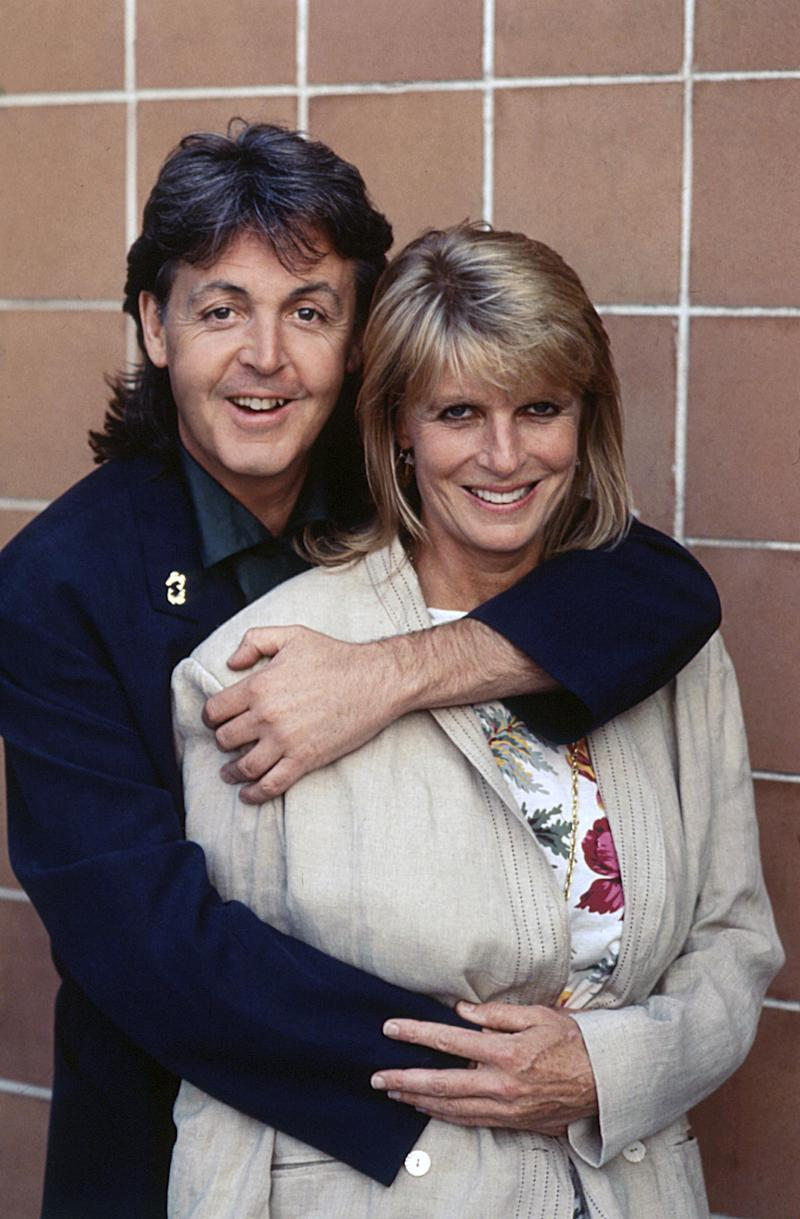 British singer-songwriter and musician Paul McCartney hugging his wife Linda Eastman. 1989 (Photo by Rino Petrosino/Mondadori Portfolio via Getty Images)