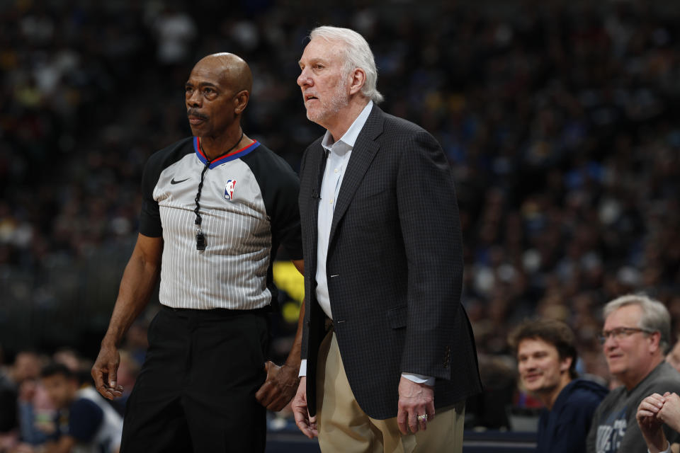 FILE - This April 13, 2019 file photo shows San Antonio Spurs head coach Gregg Popovich and referee Tom Washington (49) in the second half of Game 1 of an NBA first-round basketball playoff series in Denver. The only instances of NBA referees Washington, Tony Brown and Courtney Kirkland all officiating together are some offseason pro-am games in Atlanta, the city they all call home. That will change Sunday, March 7, 2021. The trio was chosen as the officiating crew for this year's All-Star Game. (AP Photo/David Zalubowski, File)