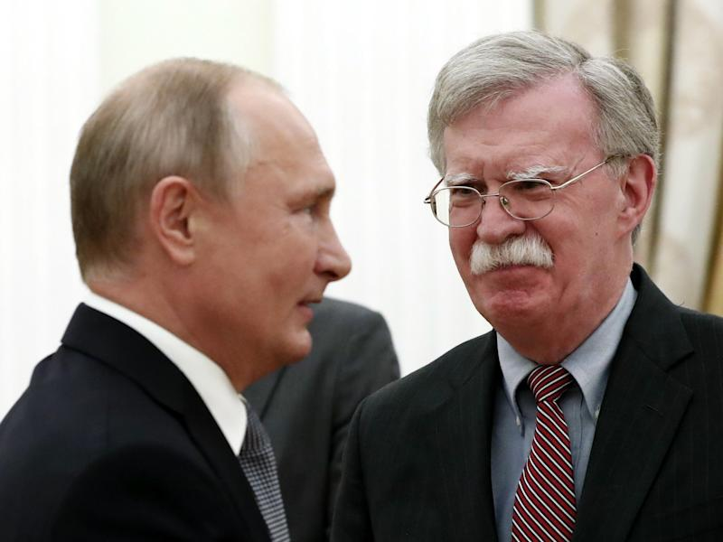 John Bolton, right, made the announcement after meeting President Putin at the Kremlin on Tuesday: AFP