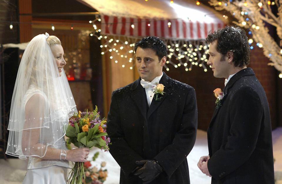 """FRIENDS -- """"The One With Phoebe's Wedding"""" -- Episode 12 -- Aired 02/12/2004 -- Pictured: (l-r) Lisa Kudrow as Phoebe Buffay, Matt LeBlanc as Joey Tribbiani, Paul Rudd as Mike Hannigan -- Photo by: NBCU Photo Bank"""