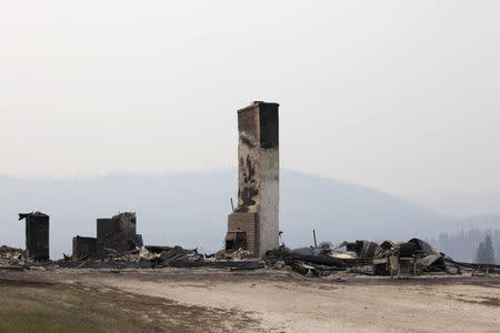 The remnants of a home consumed by the Carlton Complex Fire are pictured near Malott