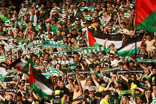 Soccer Football - Scottish Cup Final - Celtic vs Motherwell - Hampden Park, Glasgow, Britain - May 19, 2018 Celtic fans display Palestine flags during the match Action Images via Reuters/Jason Cairnduff