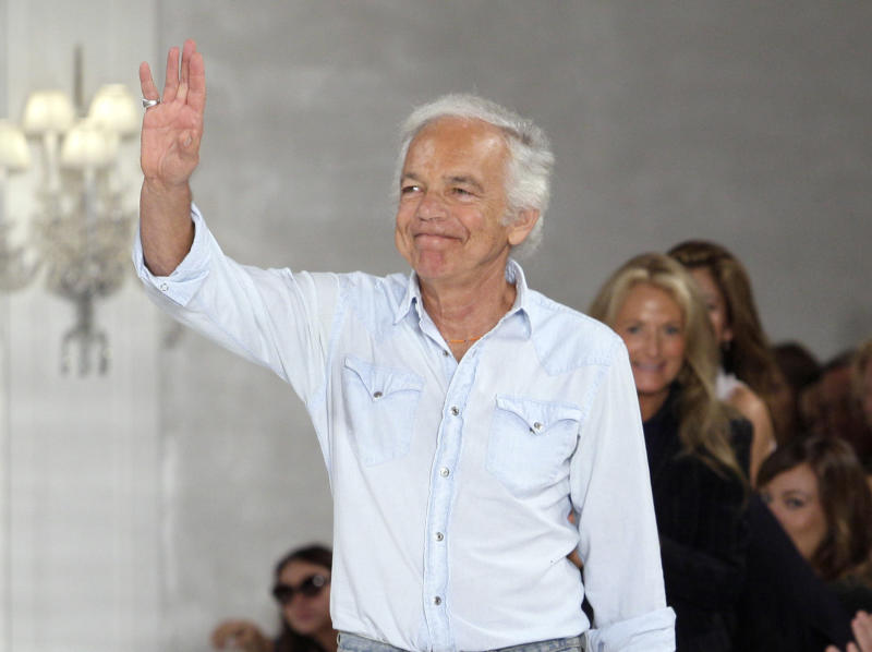 """FILE - This Sept. 15, 2011 file photo shows designer Ralph Lauren acknowledging the audience after the spring 2012 Ralph Lauren Collection was modeled during Fashion Week in New York. PBS' """"Masterpiece"""" program said Monday, Sept. 10, 2012, that the Ralph Lauren Corp. will become a national sponsor, marking the company's first TV sponsorship. """"Masterpiece"""" executive producer Rebecca Eaton called Lauren's support a tribute to the program, home of the hit British period drama """"Downton Abbey."""" During last February's New York Fashion Week, Lauren presented his fall 2012 collection to music from """"Downton Abbey,"""" telling The Associated Press that he's """"always loved the heritage and romance of England.""""(AP Photo/Richard Drew, file)"""