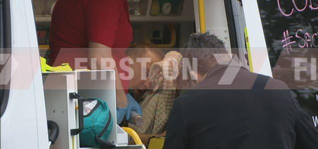 Paramedics treat victim for facial injuries after violent home invasion. Photo: 7News