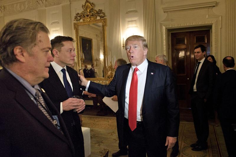 Trump advisor Steve Bannon (L) watches as US President Donald Trump greets Elon Musk, SpaceX and Tesla CEO, before a policy and strategy forum with executives in the State Dining Room of the White House: BRENDAN SMIALOWSKI/AFP via Getty Images