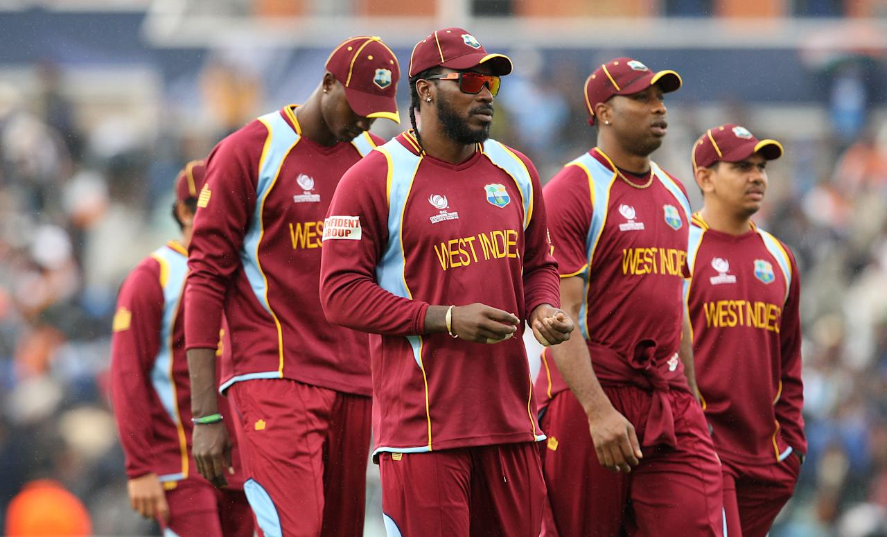 West Indies' Chris Gayle and team mates leave the field dejected after defeat to India during the ICC Champions Trophy match at the Kia Oval, London.