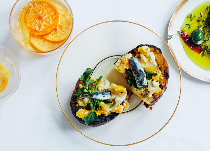 """<a href=""""https://www.bonappetit.com/recipe/crostini-with-crushed-eggs-and-salted-anchovies?mbid=synd_yahoo_rss"""" rel=""""nofollow noopener"""" target=""""_blank"""" data-ylk=""""slk:See recipe."""" class=""""link rapid-noclick-resp"""">See recipe.</a>"""