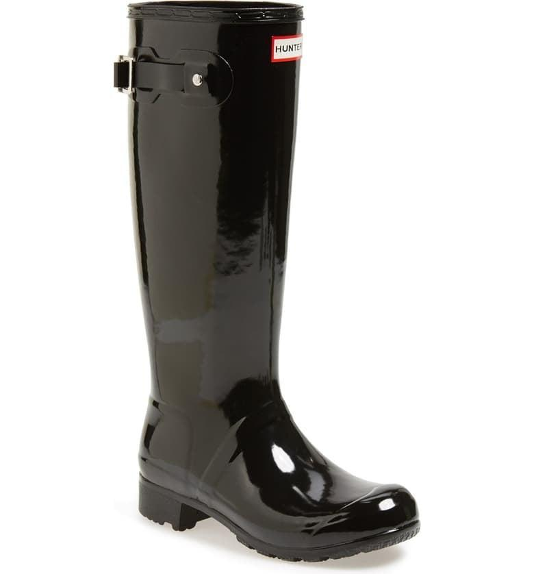 <p>These <span>Hunter Original Tall Rain Boots</span> ($160) were made to travel. Take on the toughest storms in protective, cute boots.</p>