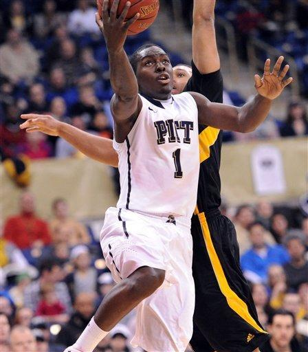 Pittsburgh's Tray Woodall takes his shot in front of Kennesaw State 's Myles Hamilton in the first half of an NCAA basketball game in Pittsburgh, Sunday, Dec. 23, 2012. (AP Photo/John Heller)