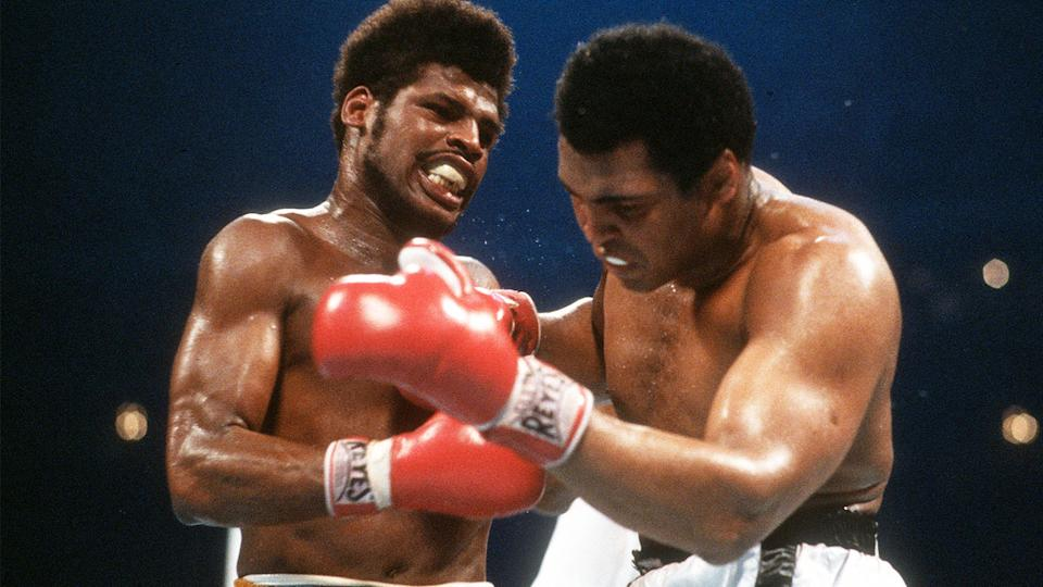 Muhammad Ali (pictured right) and Leon Spinks (pictured left) exchange punches.