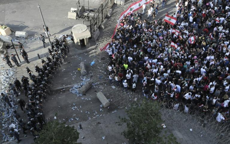 Lebanese security forces block a road as protesters rally in downtown Beirut