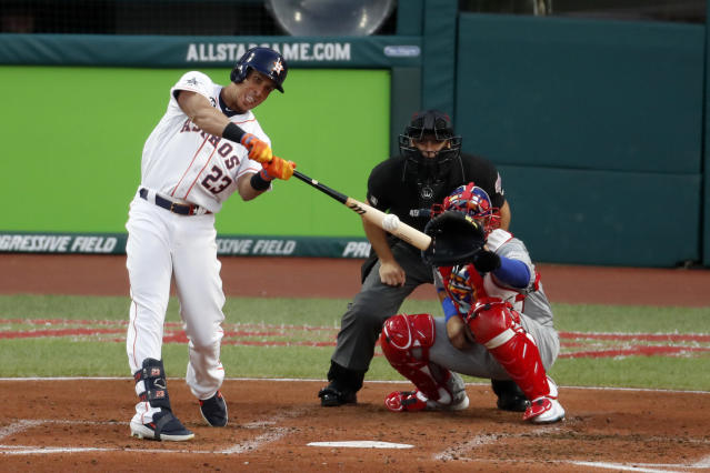 American League's Michael Brantley, of the Houston Astros, hits an RBI double during the second inning of the MLB baseball All-Star Game against the National League, Tuesday, July 9, 2019, in Cleveland. (AP Photo/Ron Schwane)