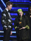 "Finneas O'Connell, left, and Billie Eilish accept the award for record of the year for ""Bad Guy"" at the 62nd annual Grammy Awards on Sunday, Jan. 26, 2020, in Los Angeles. (Photo by Matt Sayles/Invision/AP)"