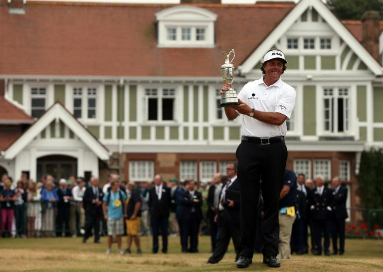 US golfer Phil Mickelson celebrates his 2013 British Open win at the Muirfield course in Scotland