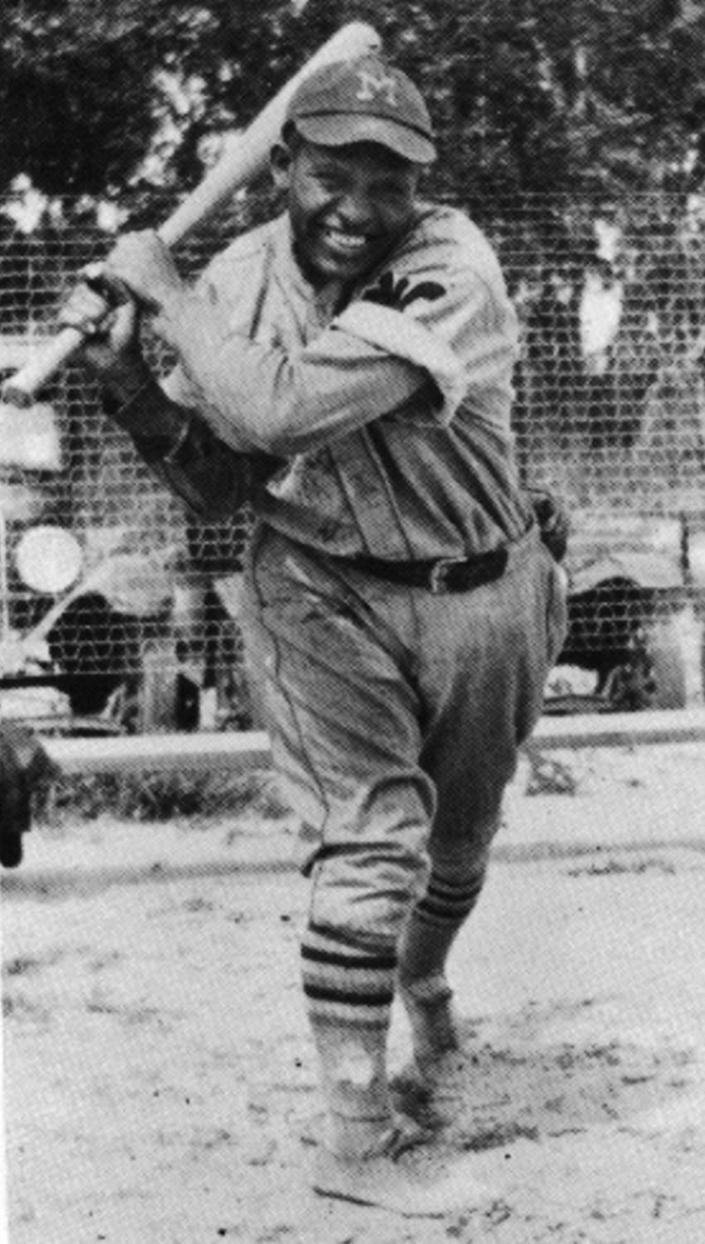 A. Hallie Harding, SS/2B/3B, is shown in the uniform of the Kansas City Monarchs.