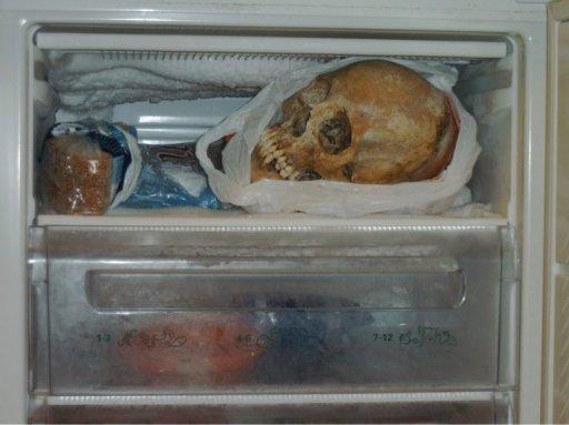 Undated police handout photo made available on November 20, shows a human skull in a freezer in the apartment of a 37-year-old woman in Gothenburg, southern Sweden. The Swedish woman was charged with possession of human skulls and bones, which the prosecution claimed she used for sexual purposes