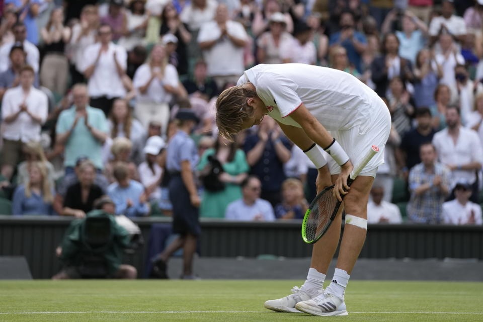 Sebastian Korda of the US reacts after winning the men's singles third round match against Britain's Daniel Evans on day five of the Wimbledon Tennis Championships in London, Friday July 2, 2021. (AP Photo/Kirsty Wigglesworth)