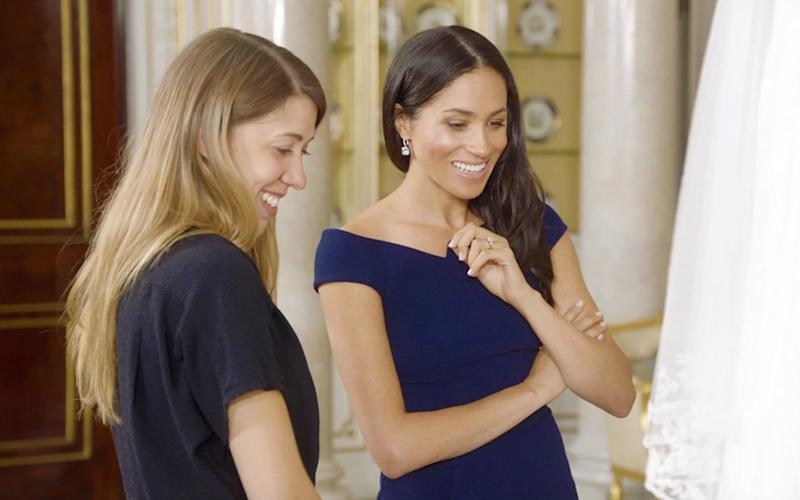 Meghan Duchess of Sussex meets Hannah Belcher, senior exhibitions coordinator of the Royal Collection  - PA
