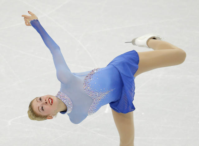 Gracie Gold of the United States competes in the women's team free skate figure skating competition at the Iceberg Skating Palace during the 2014 Winter Olympics, Sunday, Feb. 9, 2014, in Sochi, Russia. (AP Photo/Vadim Ghirda)