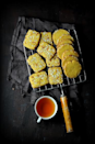 <p><b>Ingredients</b></p><p>Thandai Mix<br></p><p>¼ cup almonds (lightly toasted).<br>1 tbsp Melon seeds (charmagaz).<br>12 – 14 peppercorns.<br>1 tbsp poppy seeds (white) / poshto / khus khus.<br>1 tbsp fennel seed powder.<br>½ tsp cardamom powder.</p><p>For Cookies</p><p>120 grams butter.<br>½ cup + 2 tbsp caster sugar.<br>1¼ cups maida.<br>¼ cup + 2 tbsp Aata / wholewheat flour.<br>¼ tsp baking powder.<br>A pinch of baking soda / soda bi-carb.<br>¼ tsp saffron.<br>1½ tbsp warm milk (to soak the saffron strands)<br>½ cup Thandai mix.<br>¼ cup finely chopped almonds (optional).</p><p><b>Method</b></p><p>For the Thandai mix, in a spice blender powder the ingredients. Store in a small jar or bottle.</p><p>Crush the saffron and soak it in warm milk for at least an hour to enhance its flavor.</p><p>Whisk together the maida, corn flour, whole meal, baking powder and baking soda for half minute. Mix in the thandai mix and whisk for another half a minute. Set aside.</p><p>In a mixing bowl, whisk together the butter and sugar till light and fluffy. Mix in the saffron milk and then the flour mix. Bring together the butter and flour mix till there are no dry bits. Do not over work with the dough. (You do not need to knead the dough.)</p><p>Roll the dough into a log that is 7 to 7½ inch long. Tightly wrap the rolled dough in a cling film to retain its shape. Store in refrigerator for at least 2 hours (to obtain a hard dough so that it can be easily sliced).</p><p>Preheat the oven at 170 degrees C for five minutes.</p><p>Unwrap the cling film and slice the cookie dough log in half inch thick slices and arrange them on a baking sheet at least half a centimetre gap. Bake the cookies in the preheated oven for 10 – 12 minutes or till the edges begin to turn golden brown.</p><p>Remove the baking sheet from the oven and allow the cookies to cool on the baking sheet for 5 minutes before carefully transferring them on to the wire rack. Cool completely before storing them in an air tig