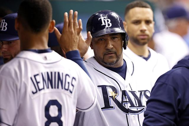 Tampa Bay Rays' Jose Molina, right, is congratulated by teammate Desmond Jennings after scoring during the third inning of an interleague baseball game against the San Francisco Giants Saturday, Aug. 3, 2013, in St. Petersburg, Fla. (AP Photo/Mike Carlson)