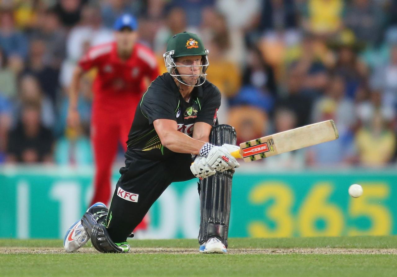 HOBART, AUSTRALIA - JANUARY 29:  Cameron White of Australia reverse sweeps during game one of the International Twenty20 series between Australia and England at Blundstone Arena on January 29, 2014 in Hobart, Australia.  (Photo by Scott Barbour/Getty Images)