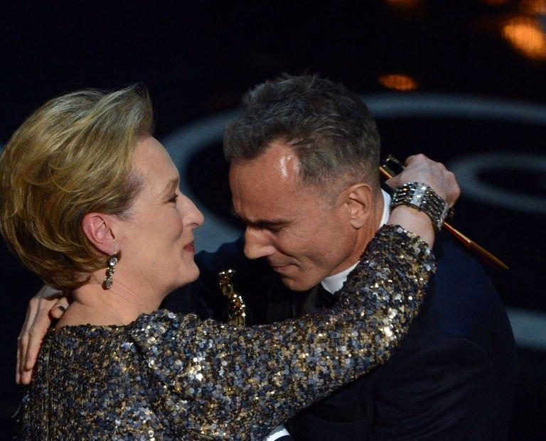 """Actress Meryl Streep presents the trophy for Best Actor to Daniel Day-Lewis onstage at the 85th Annual Academy Awards on February 24, 2013 in Hollywood, California. Ben Affleck's Iran hostage drama """"Argo"""" won the coveted best film Oscar late Sunday, while Daniel Day-Lewis took a record third best actor prize at the 85th Academy Awards, Hollywood's biggest night"""