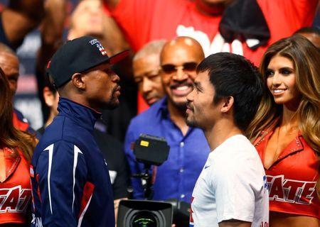 FILE PHOTO: May 1, 2015; Las Vegas, NV, USA; Floyd Mayweather (left) stares at Manny Pacquiao during weigh-ins for the boxing fight at MGM Grand Garden Arena. Mandatory Credit: Mark J. Rebilas-USA TODAY Sports