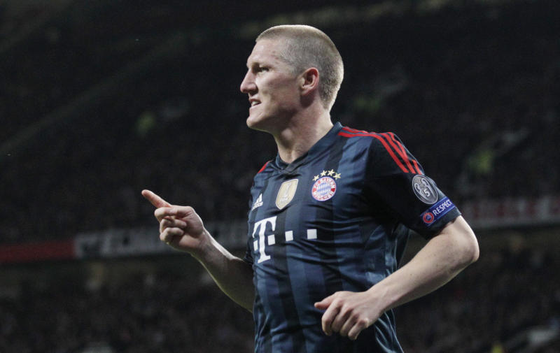 Bayern's Bastian Schweinsteiger celebrates scoring his side's first goal during the Champions League quarterfinal first leg soccer match between Manchester United and Bayern Munich at Old Trafford Stadium, Manchester, England, Tuesday, April 1, 2014.(AP Photo/Jon Super)