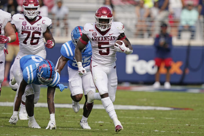 Arkansas running back Raheim Sanders (5) runs past Mississippi defenders for a first down during the second half of an NCAA college football game, Saturday, Oct. 9, 2021, in Oxford, Miss. Mississippi won 52-51.(AP Photo/Rogelio V. Solis)
