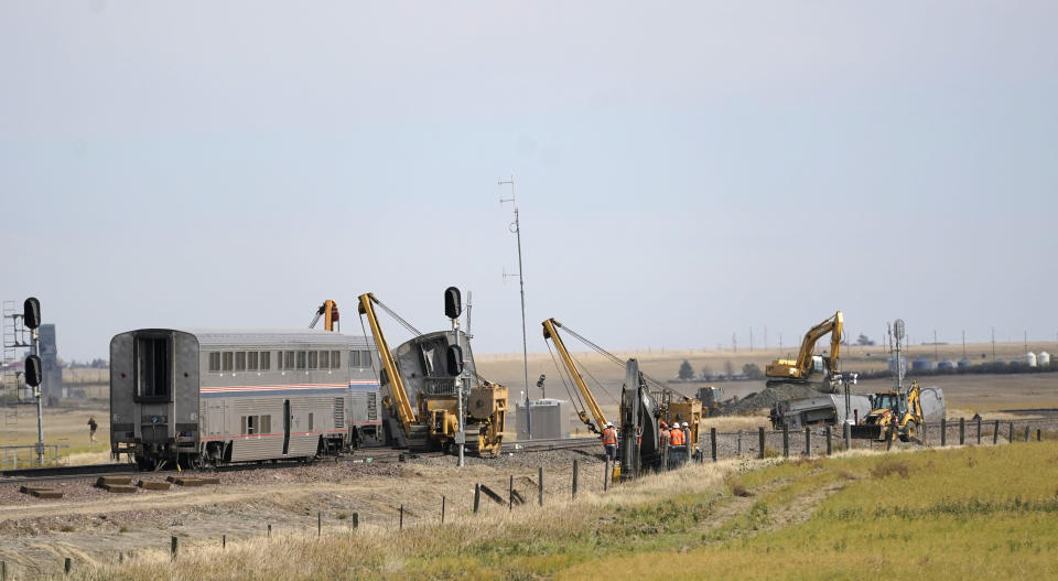 Heavy equipment is shown Sunday, Sept. 26, 2021, next to cars from an Amtrak train that derailed a day earlier just west of Joplin, Mont., killing three people and injuring others. The westbound Empire Builder was en route to Seattle from Chicago, with two locomotives and 10 cars. (AP Photo/Ted S. Warren)